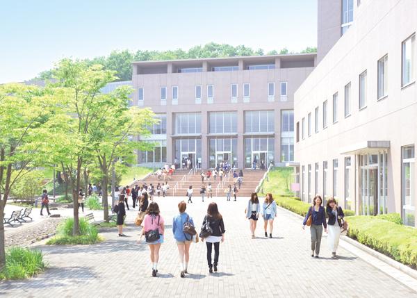 キャンパス:上からみると翼を広げた鳥のような形の教室棟。各教室や学生ホール、図書館などがあり、本館とクレセントホールへは渡り廊下でつながっています。